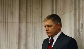 Robert Fico, head of Slovakia's Smer-Social Democracy party, looks on during a parliamentary session in Bratislava, Slovakia, on Tuesday, Oct. 11, 2011. Lawmakers voted against a measure to boost the European Union bailout fund. (AP Photo/Petr David Josek)