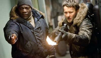 """Adewale Akinnuoye-Agbaje (left) and Joel Edgerton are gruff American heavies who hang around long enough to provide some muscle when the going gets tough in the latest version of """"The Thing."""" (Universal Pictures via Associated Press)"""