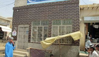 The June robbery of this bank in Dera Ismail Khan was part of a Taliban shift to crime inside Pakistan to pay for militant activities. (Associated Press)