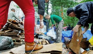 Demonstrators at Zuccotti Park begIn collecting trash and sprucing up the site on Thursday in advance of a planned cleaning on Friday of the private park by its owners. The Occupy Wall Street protesters have been camped out at the park in Manhattan for nearly a month. (Associated Press)