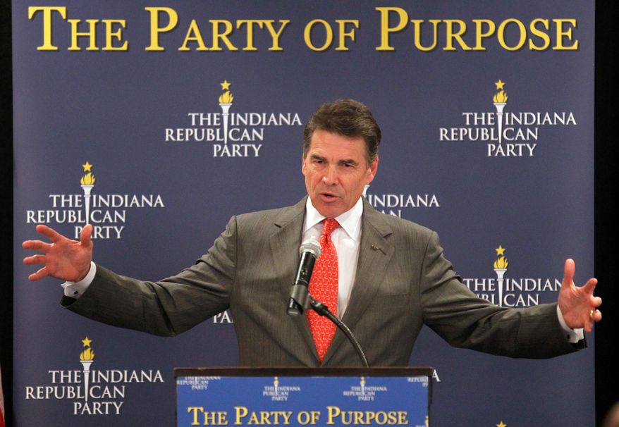 Texas Gov. Rick Perry, a Republican presidential candidate, speaks at a GOP forum in Indianapolis on Wednesday. Backers are saying he failed to reach out to evangelical Christians and has done a poor job on using surrogates. (Associated Press)