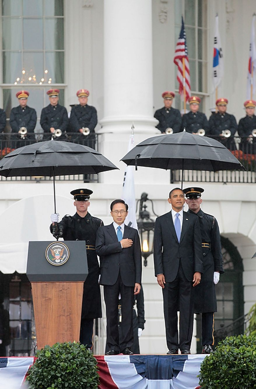 President Obama welcomes South Korean President Lee Myung-bak during a state arrival ceremony on the South Lawn of the White House in Washington on Thursday, Oct. 13, 2011. (AP Photo/Pablo Martinez Monsivais)