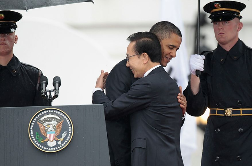 President Obama greets South Korean President Lee Myung-bak during a state arrival ceremony on the South Lawn of the White House in Washington on Thursday, Oct. 13, 2011. (AP Photo/Pablo Martinez Monsivais)