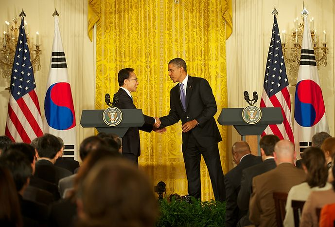 President Obama greets South Korean President Lee Myung-bak before their joint news conference in the East Room of the White House on Thursday afternoon. Later in the day, Mr. Lee addressed Congress before Mr. Obama welcomed him back to the White House for a state dinner. (Mary F. Calvert/Special to The Washington Times)