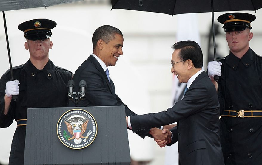 President Barack Obama welcomes South Korean President Lee Myung-bak during a state arrival ceremony on the South Lawn of the White House in Washington, Thursday, Oct., 13, 2011. (AP Photo/Pablo Martinez Monsivais