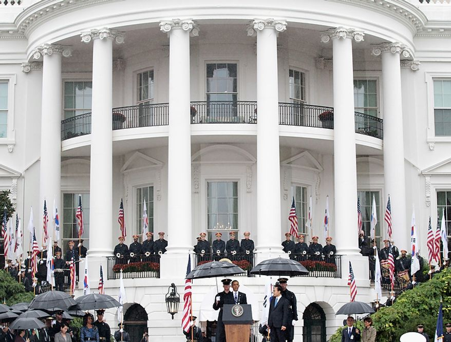 President Barack Obama speaks as he welcomes South Korean President Lee Myung-bak during a state arrival ceremony on the South Lawn of the White House in Washington, Thursday, Oct., 13, 2011. (AP Photo/Pablo Martinez Monsivais