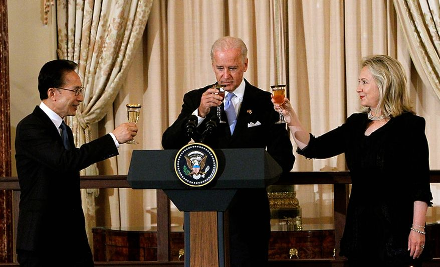 Secretary of State Hillary Rodham Clinton, Vice President Joe Biden, and South Korean President Lee Myung-bak, toast each other during a luncheon at the State Department in Washington, Thursday, Oct. 13, 2011.  (AP Photo/Ann Heisenfelt)