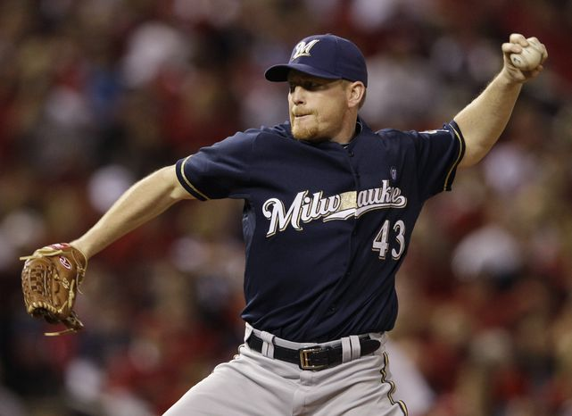Milwaukee Brewers starting pitcher Randy Wolf throws during the first inning of Game 4 of baseball's National League championship series against the St. Louis Cardinals Thursday, Oct. 13, 2011, in St. Louis. (AP Photo/David J. Phillip)
