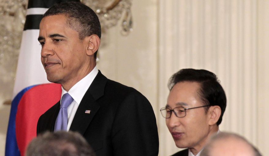 President Obama and South Korean President Lee Myung-bak arrive for a joint news conference at the White House on Oct., 13, 2011. (Associated Press)