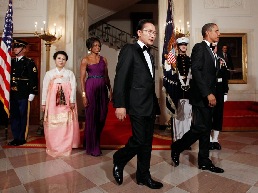 President Barack Obama and first lady Michelle Obama walk with South Korean President Lee Myung-bak and his wife Kim Yoon-ok as they welcome them to a State Dinner at the White House in Washington, Thursday, Oct. 13, 2011. (AP Photo/Charles Dharapak)