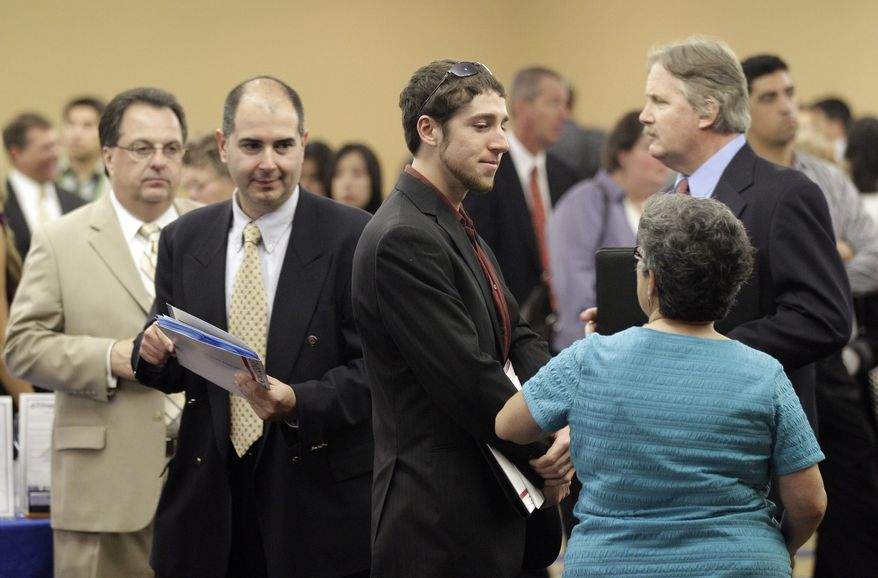 Job seekers interact with prospective employers during a job fair in San Mateo, Calif., on Thursday, Sept. 1, 2011. (AP Photo/Marcio Jose Sanchez)
