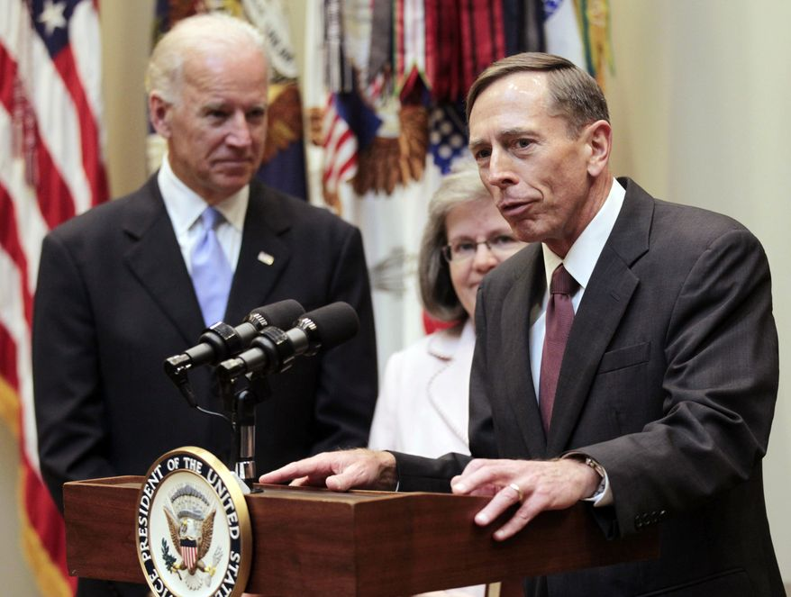** FILE ** In this Sept. 6, 2011, file photo, new CIA director David Petraeus, right, speaks following his swearing-in ceremony with his wife Holly Knowlton Petraeus, center, and Vice President Joe Biden, left, in the Roosevelt Room of the White House in Washington. (AP Photo/Pablo Martinez Monsivais, File)