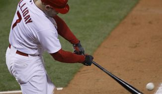 St. Louis Cardinals' Matt Holliday had three hits and two RBI against the Milwaukee Brewers on Friday. (AP Photo/Charles Rex Arbogast)