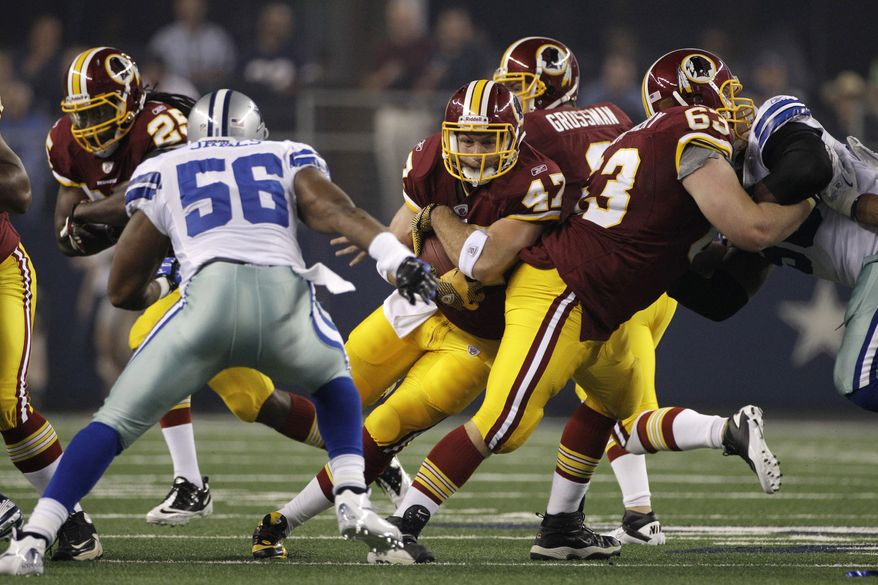 ** FILE ** Washington Redskins left guard (playing center in this photo) Will Montgomery provides a running lane for Chris Cooley against the Dallas Cowboys on Monday, Sept. 26, 2011. (AP Photo/Tony Gutierrez, File)