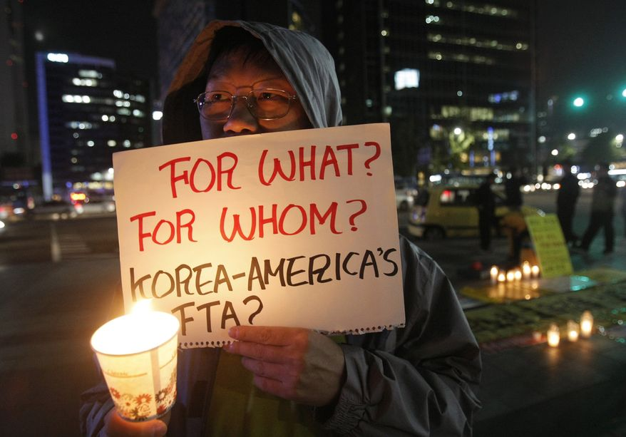 A South Korean protester participates in a rally against a free trade agreement between South Korea and the United States near the U.S. Embassy in Seoul on Oct. 12, 2011. (Associated Press)
