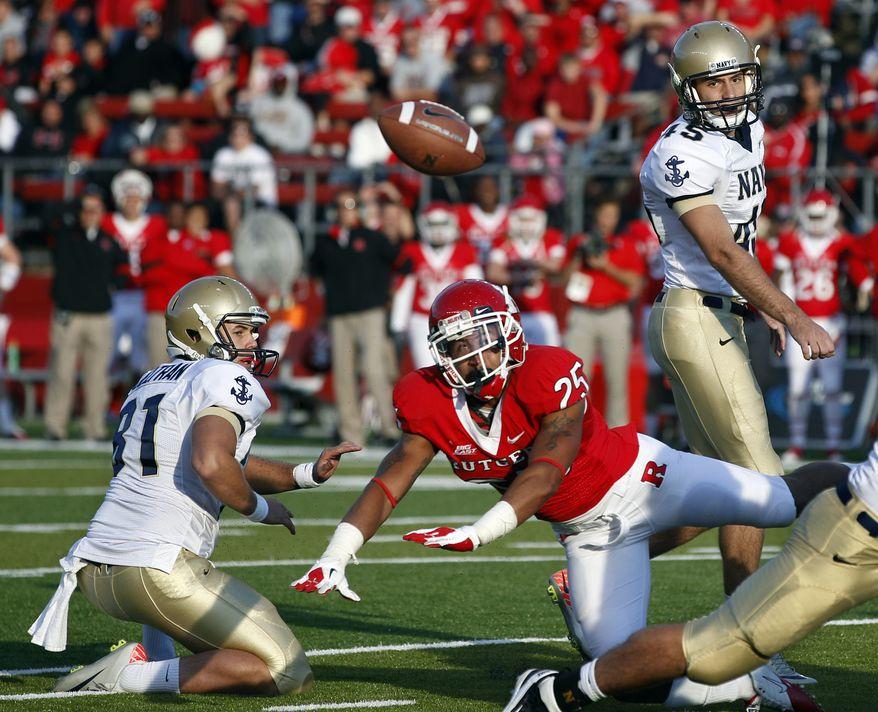 Rutgers defensive back Brandon Jones (25) blocks a field goal attempt by Navy kicker Jon Teague (45)  in the fourth quarter in Piscataway, N.J., Saturday, Oct. 15, 2011. Rutgers won 21-20. (AP Photo/Mel Evans)