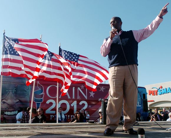 Republican presidential candidate Herman Cain speaks to a crowd at Bob's House of Honda as part of his bus tour, Friday, Oct. 14, 2011, in Jackson, Tenn. (AP Photo/The Jackson Sun, Kenneth Cummings)