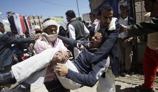 Anti-government protestors carry a wounded protestor from the site of clashes with security forces, in Sanaa, Yemen, Saturday, Oct. 15, 2011. Medical officials in Yemen say security forces have fired on protesters in the capital Sanaa, killing several and wounding dozens. (AP Photo/Hani Mohammed)