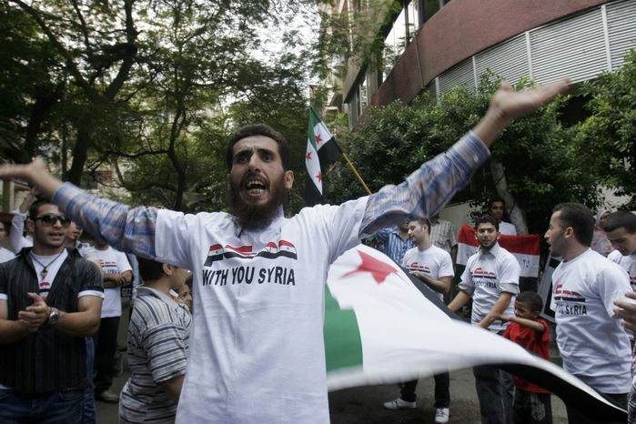 A man chants slogans during a demonstration against Syrian President Bashar Assad in front of the Syrian embassy in Cairo, Egypt, Saturday, Oct. 15, 2011. (AP Photo/Mohammed Abu Zaid)
