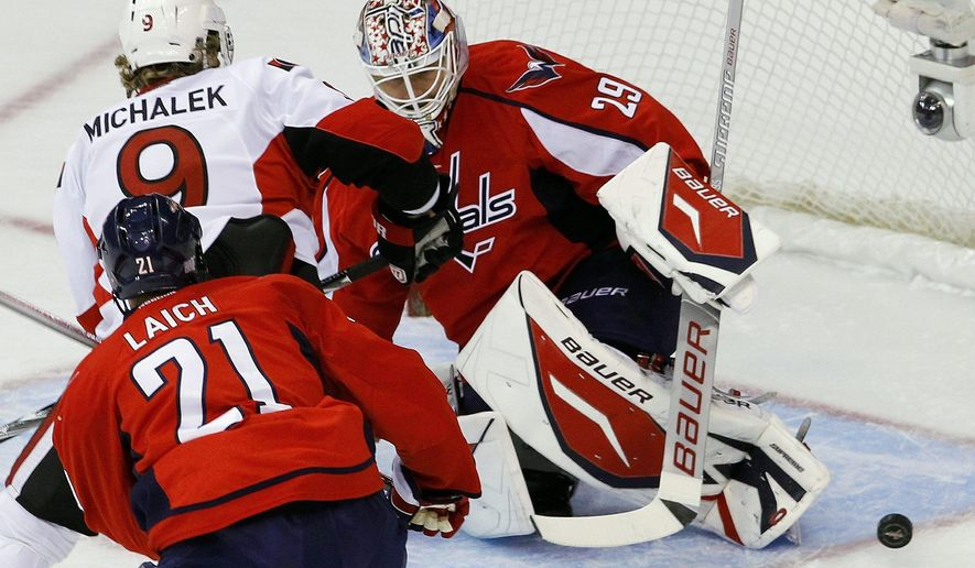 Washington goaltender Tomas Vokoun stops a shot by Ottowa left wing Milan Michalek during the Capitals' 2-1 win Saturday at Verizon Center. Vokoun recorded 33 saves as Washington moved to 4-0. (Associated Press)