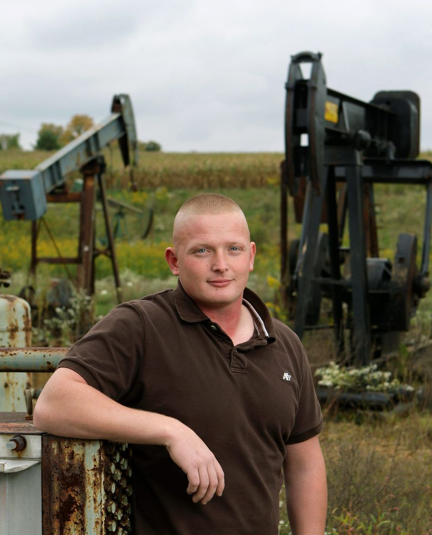 The natural gas industry has changed the career path for Cory May, 23, standing next to pump jacks at a storage facility in Zanesville, Ohio. After completing an 80-hour shale exploration certification course, the Marine combat veteran got a job cementing wells for Halliburton that will pay $60,000 to $70,000 a year. (Associated Press)