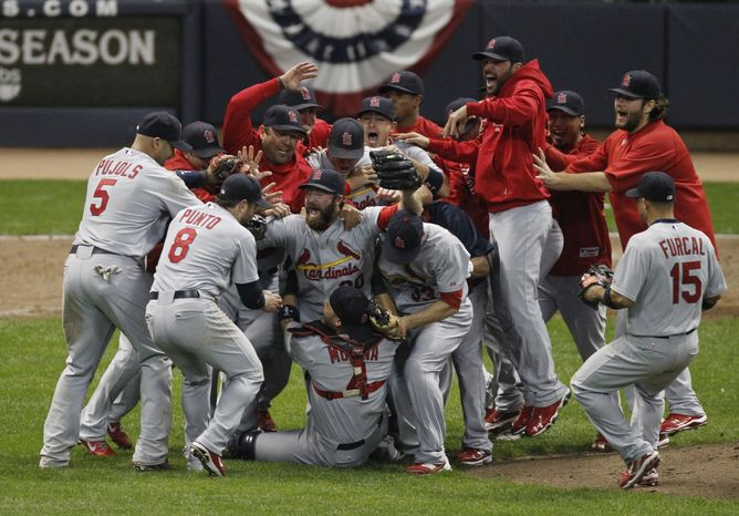 The St. Louis Cardinals celebrate after Game 6 of baseball's National League championship series against the Milwaukee Brewers Sunday, Oct. 16, 2011, in Milwaukee. The Cardinals won 12-6 to win the series and advance to the World Series. AP Photo/Jeff Roberson)