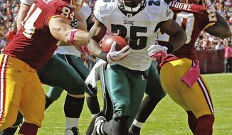 Philadelphia Eagles running back LeSean McCoy breaks free of Washington Redskins defensive end Adam Carriker while running for a touchdown during the first half in Landover, Md., Sunday, Oct. 16, 2011. (AP Photo/Pablo Martinez Monsivais)