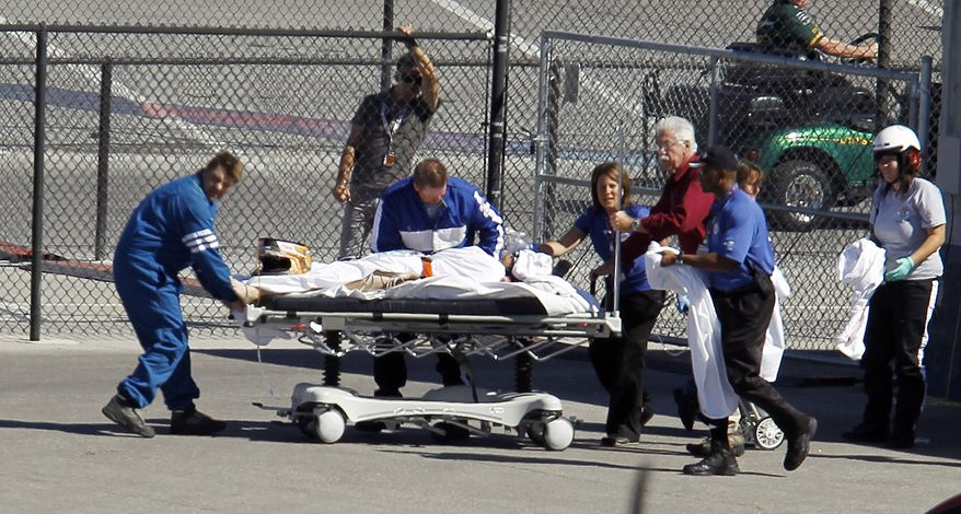 Dan Wheldon, of England, is transported to a medical helicopter following a crash early in the IndyCar Series' Las Vegas Indy 300 auto race Sunday, Oct. 16, 2011, in Las Vegas. (AP Photo/Isaac Brekken)