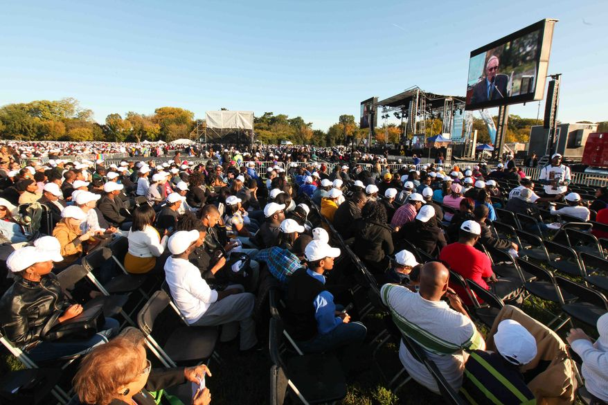 Thousands gather for the dedication of the Martin Luther King Jr. Memorial on Sunday, Oct. 16, 2011, in Washington. (AP Photo/The News Journal, Suchat Pederson)