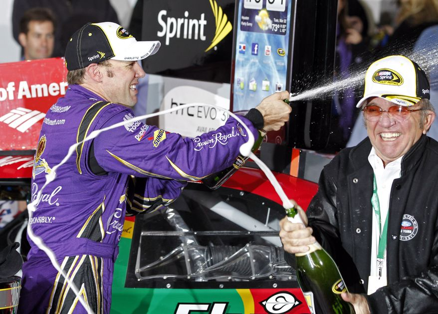 Matt Kenseth and team owner Jack Roush spray champagne as they celebrate Kenseth's win in the NASCAR Sprint Cup Series auto race at Charlotte Motor Speedway in Concord, N.C., Saturday, Oct. 15, 2011. (AP Photo/Terry Renna)