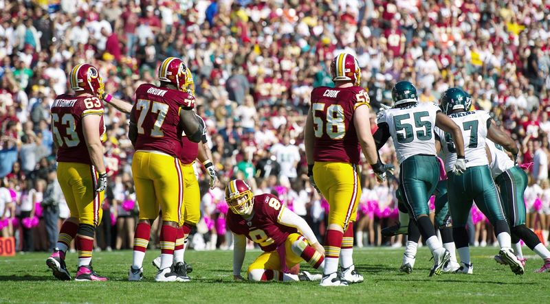 Washington Redskins QB Rex Grossman (8) is slow to get up after a sack for a loss of eight yards by the Philadelphia Eagles during the second quarter at FedEx Field in Landover, Md. on Sunday, Oct. 16, 2011. (Andrew Harnik / The Washington Times)