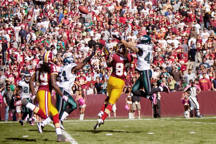 A pass intended for Washington Redskins Fred Davis (83) is intercepted by Philadelphia Eagles Kurt Coleman (42) during the first quarter. (Pratik Shah / The Washington Times)