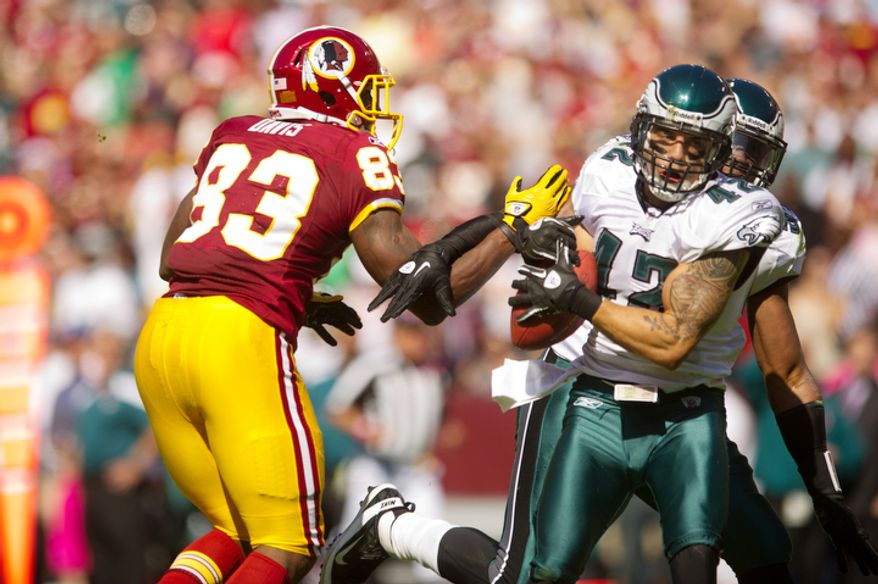 A pass intended for Washington Redskins Fred Davis (83) is intercepted by Philadelphia Eagles Kurt Coleman (42) during the first quarter. (Andrew Harnik / The Washington Times)