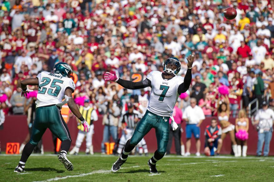 Philadelphia Eagles quarterback Michael Vick (7) watches a snap sail over his head during play against the Washington Redskins during the first quarter. (Andrew Harnik / The Washington Times)