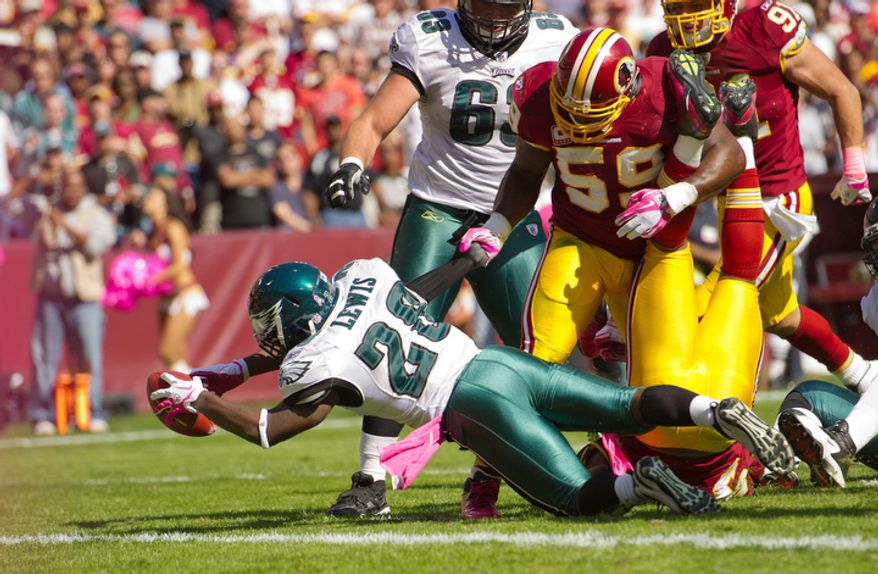 Washington Redskins London Fletcher (59) pulls Philadelphia Eagles Dion Lewis down before he could break the plane of the endzone during the first quarter. (Andrew Harnik / The Washington Times)