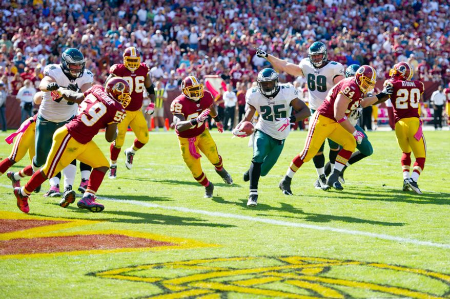 The Washington Redskins can't stop Philadelphia Eagles LeSean McCoy (25) from picking up their 2nd touchdown during the second quarter at FedEx Field. (Rod Lamkey Jr. / The Washington Times)