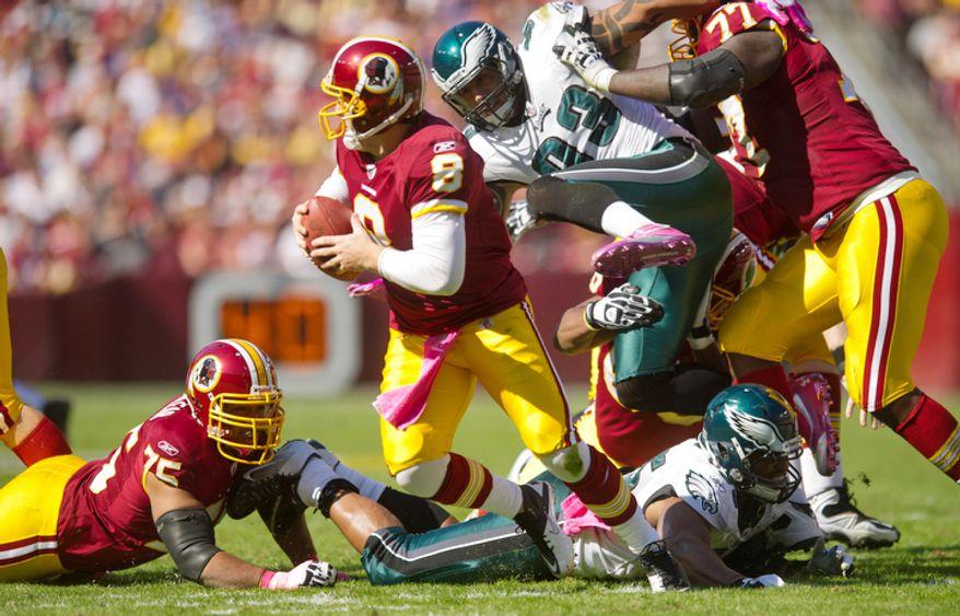 Washington Redskins quarterback Rex Grossman is pressured by the Philadelphia Eagles during the second quarter. (Andrew Harnik / The Washington Times)