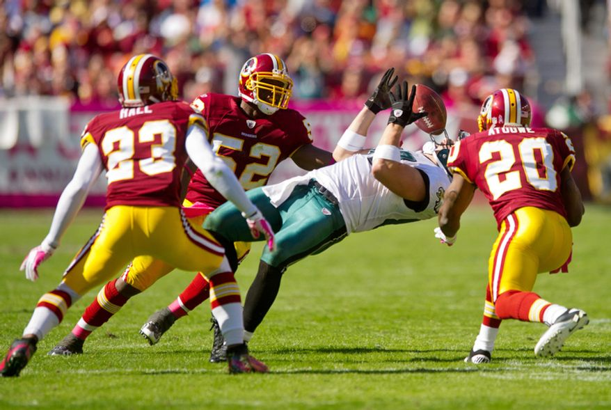 The Washington Redskins can only watch as Philadelphia Eagles Brent Celek catches a 21 yard pass during the second quarter. (Andrew Harnik / The Washington Times)