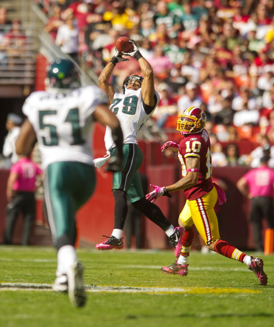 A deep pass intended for Washington Redskins Jabar Gaffney (10) is intercepted by Philadelphia Eagles Nate Allen (29) during the second quarter. (Andrew Harnik / The Washington Times)