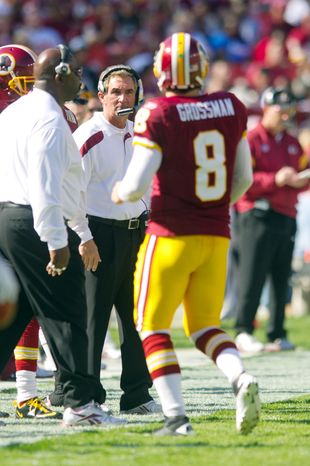 Washington Redskins head coach Mike Shanahan looks at quarterback Rex Grossman (8) leaving the field after throwing an interception to the Philadelphia Eagles during the second quarter. (Andrew Harnik / The Washington Times)