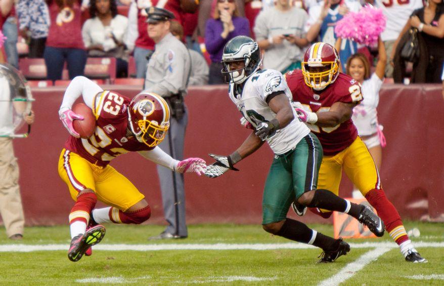 Washington Redskins DeAngelo Hall (23) runs with an interception against the Philadelphia Eagles during the third quarter at FedEx Field. (Pratik Shah / The Washington Times)