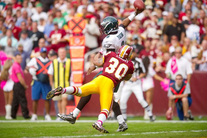 Washington Redskins LaRon Landry (30) pressures Philadelphia Eagles Vince Young (9) into throwing an interception during the third quarter. (Andrew Harnik / The Washington Times)