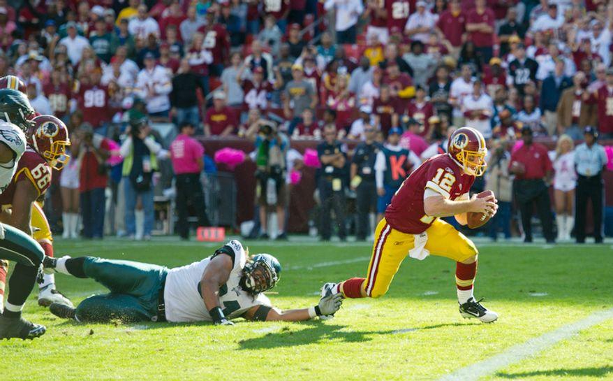 Washington Redskins quarterback John Beck (12) runs in a two yard touchdown against the Philadelphia Eagles during the fourth quarter. (Rod Lamkey Jr. / The Washington Times)