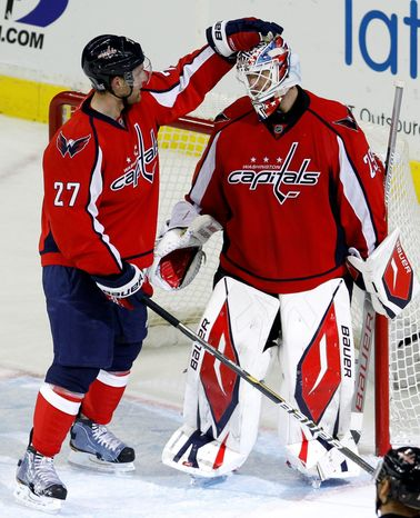 Capitals goalie Tomas Vokoun has defensemen such as Karl Alzner (27)  to thank for seeing fewer pucks. (Associated Press)