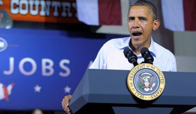 **FILE** President Obama speaks Oct. 17, 2011, at West Wilkes High School in Millers Creek, N.C., where his three-day bus tour promoting the American Jobs Act made a stop. (Associated Press)