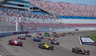 Drivers took five tribute laps in honor of Dan Wheldon, who died following a 15-car crash in the Las Vegas Indy 300 earlier Sunday. The race, the season finale on the IndyCar circuit, did not resume. (Associated Press)