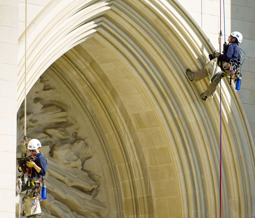 """Difficult access team"" engineers Katie Francis (left) and Emma Cardini check the National Cathedral on Monday for potential unseen damage caused by the 5.8 magnitude earthquake that shook the District in August. (Andrew Harnik/The Washington Times)"