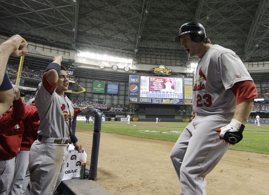 St. Louis Cardinals' David Freese reacts after hitting a three-run home run during the first inning of Game 6 of baseball's National League championship series against the Milwaukee Brewers Sunday, Oct. 16, 2011, in Milwaukee. (AP Photo/David J. Phillip)