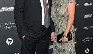 ** FILE ** Actress Shannen Doherty (right) and Kurt Iswarienko attend the Gentleman's Ball, hosted by GQ magazine, at the Edison Ballroom in New York in October 2010. (AP Photo/Evan Agostini, File)