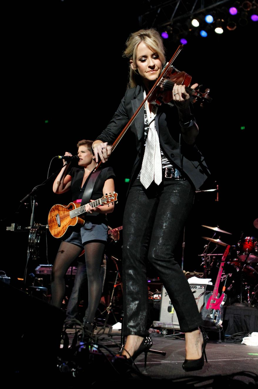 The Dixie Chicks didn't fiddle around before accepting an invitation to participate in a concert to help raise money for victims of the Texas wildfires this summer. (Associated Press)
